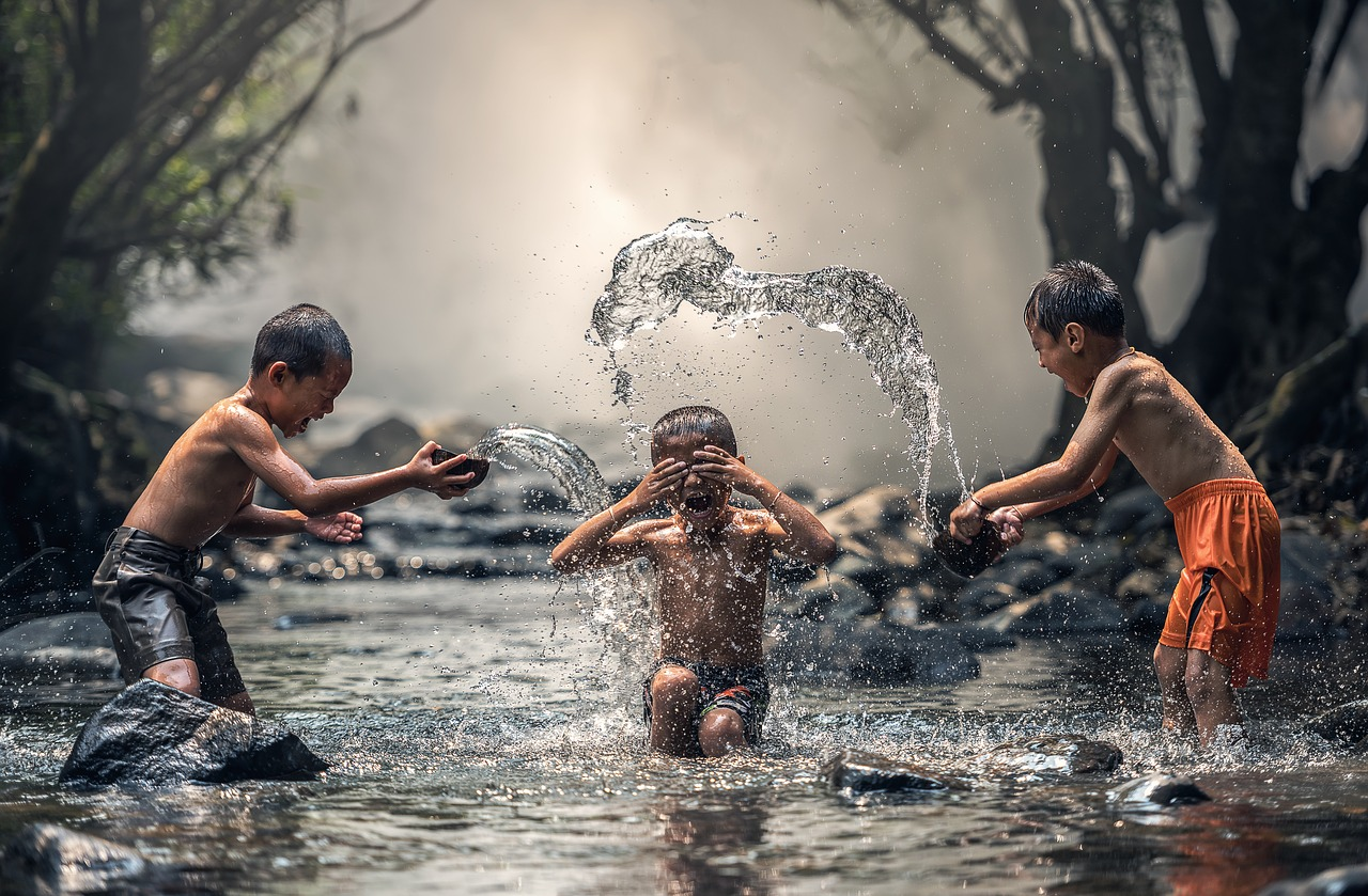 boys playing in a creek