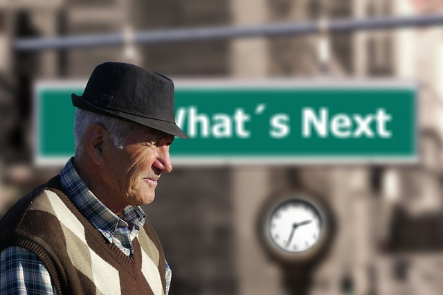 elderly man by what's next sign